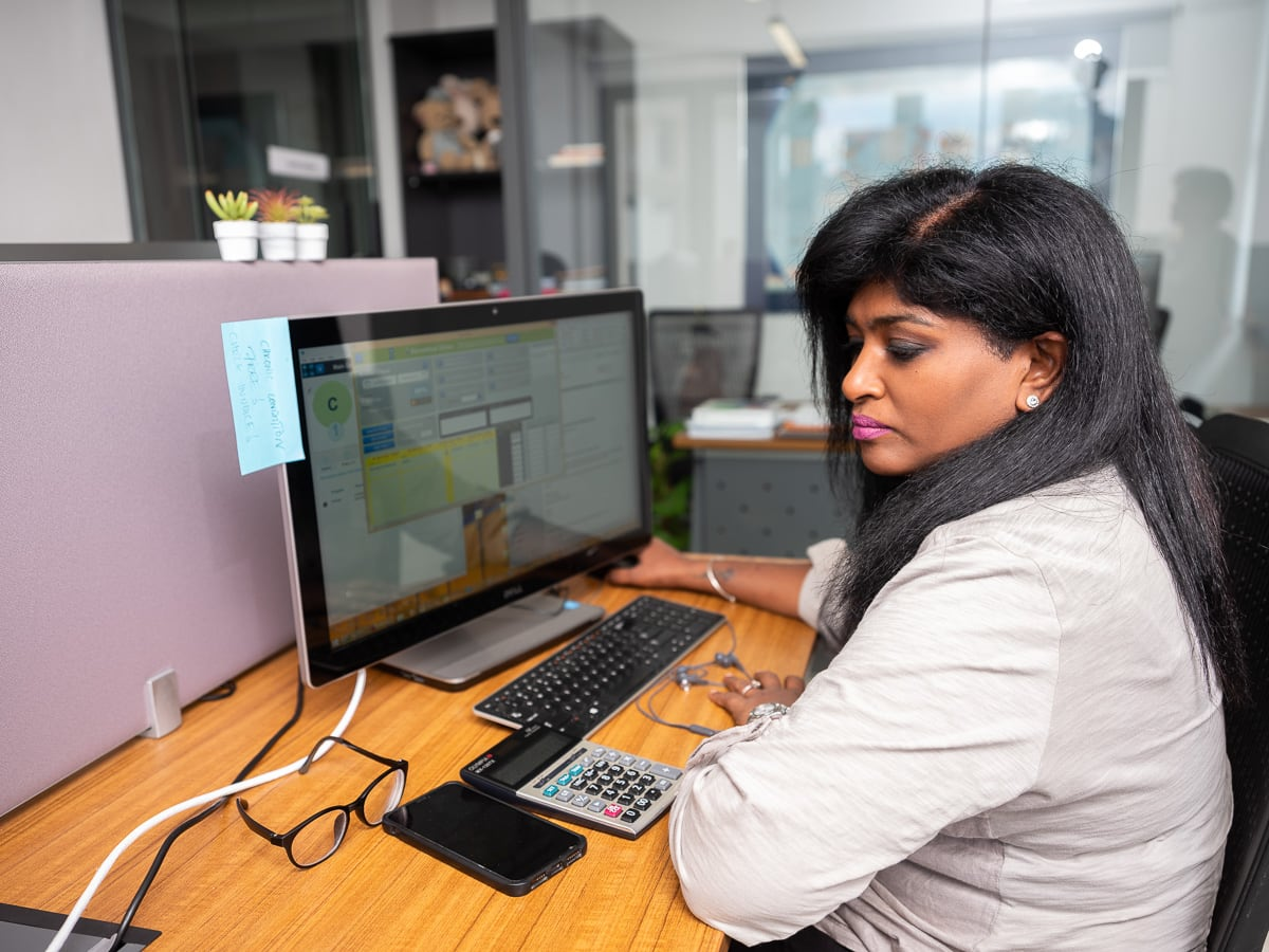 Customer success specialist calculating the medical insurance premiums for missionary members